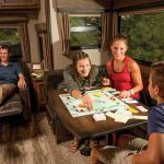 Can children play board games in the dining area when RV is moving?