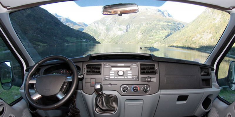 What should I do if a stone chips the rental RV's windshield?